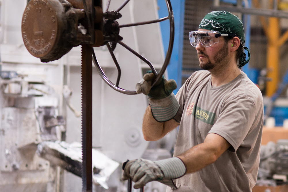Man working in an industrial workshop wearing eye tracking glasses