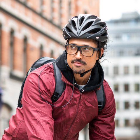 A man biking wearing Tobii Pro Glasses 3 and a helmet