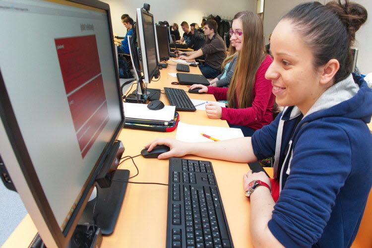 Student looking at a computer screen case study Bratislava University
