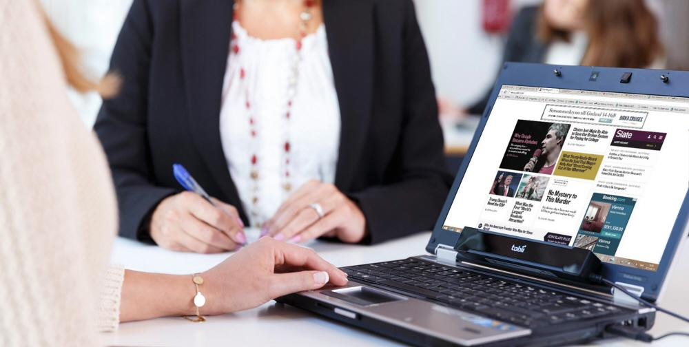 A laptop with the Tobii Pro X2-60 eye tracker monted on it.