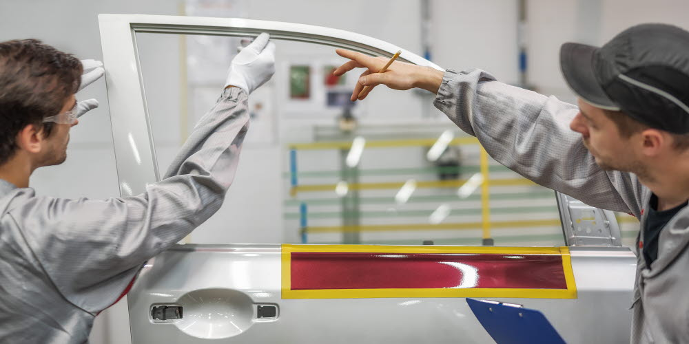 Person training another person on how to install a car window