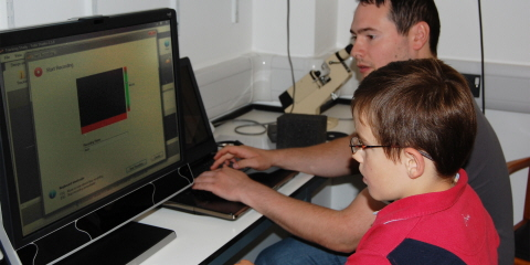 A young participant going through the calibration process on the T60XL eye tracker.