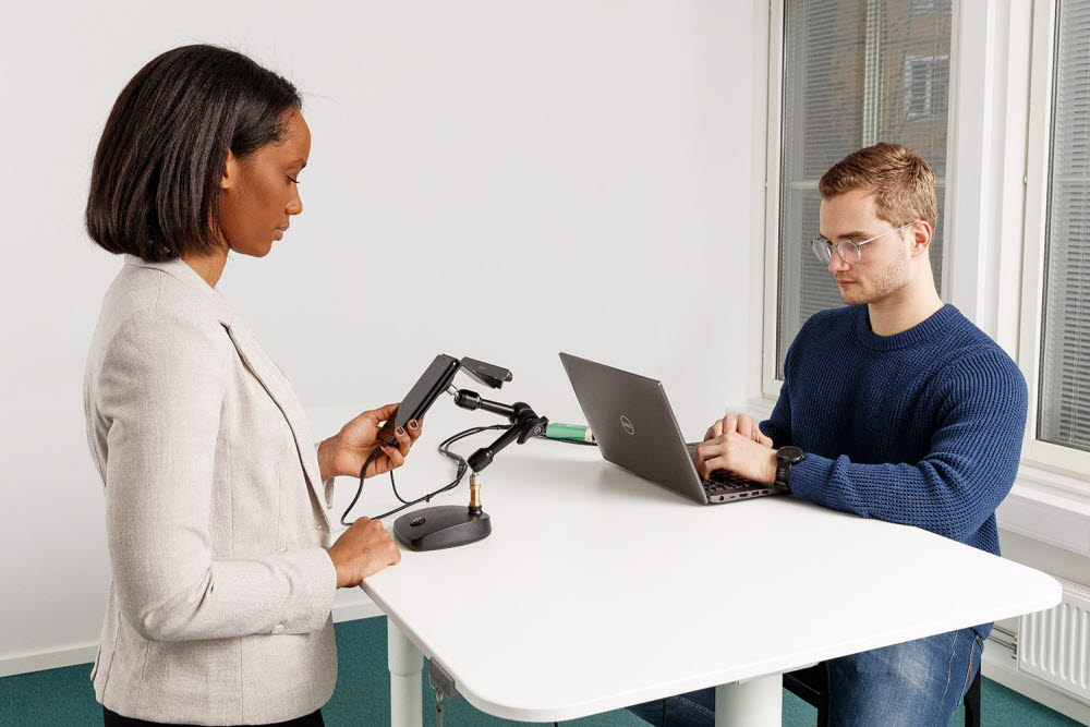 Woman and a man running an eye tracking test using a mobile testing accessory