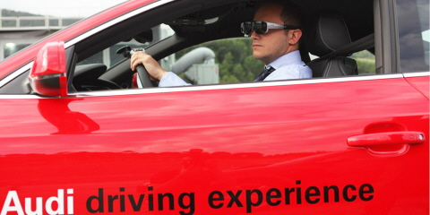 A man driving an Audi car wearing Tobii Pro Glasses.