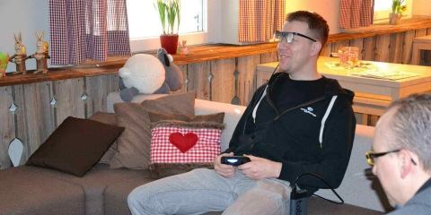 A user testing a game wearing Tobii Pro Glasses 2 eye tracker.