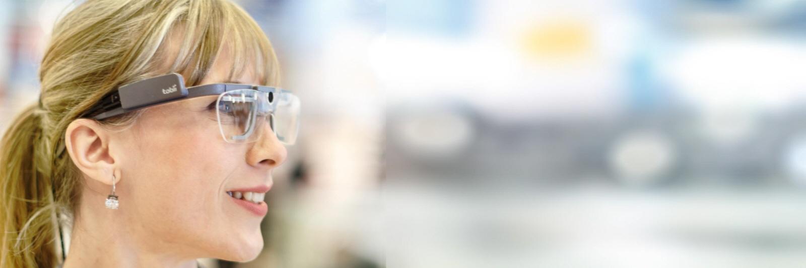 A woman wearing Tobii Pro Glasses 2.