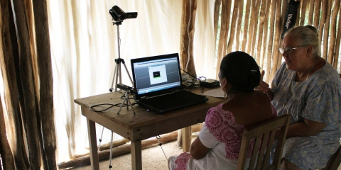 Mayan test participant in front of the Tobii Pro X2-60.