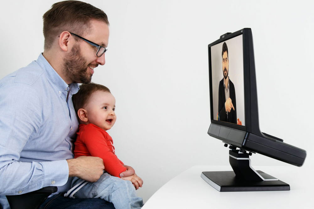 An infant looking at the Tobii Pro TX300 eye tracker's screen