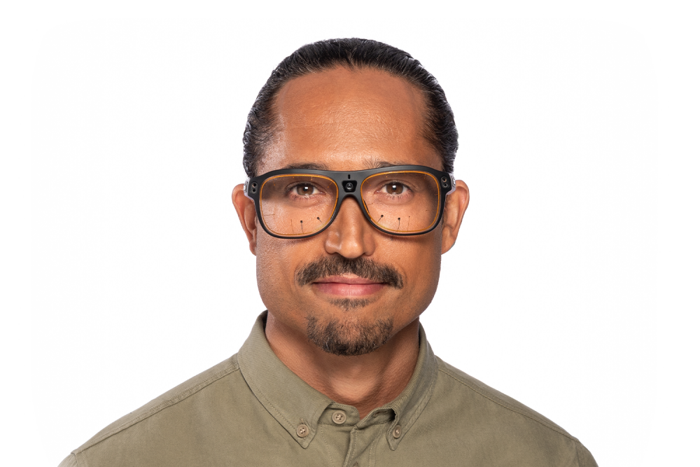 Head shot of a man with Tobii Pro Glasses 3