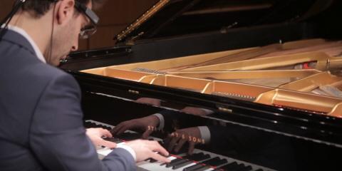 Professor Daniel Beliavsky wearing Tobii Pro Glasses 2 while playing piano