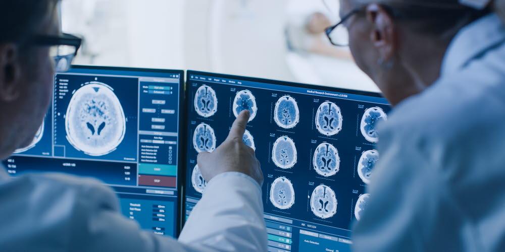 2 Doctors reviewing cat scans