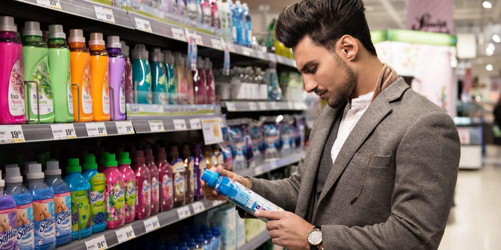 Man looking at packaging information
