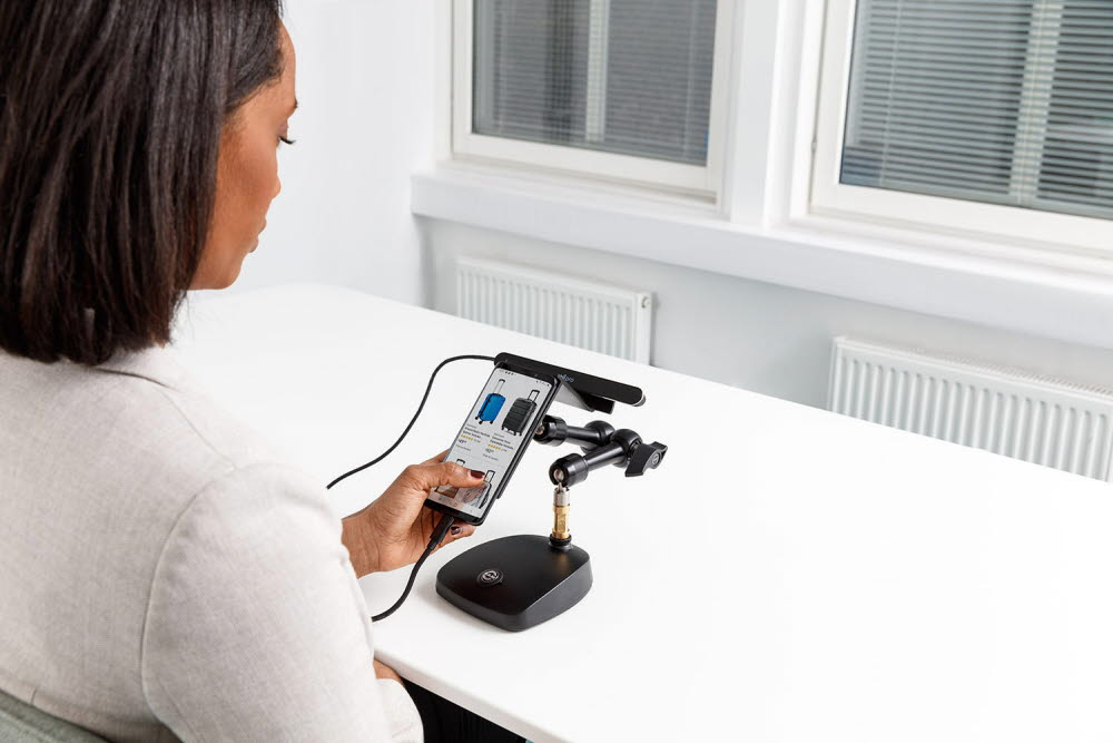 Woman using a mobile testing device