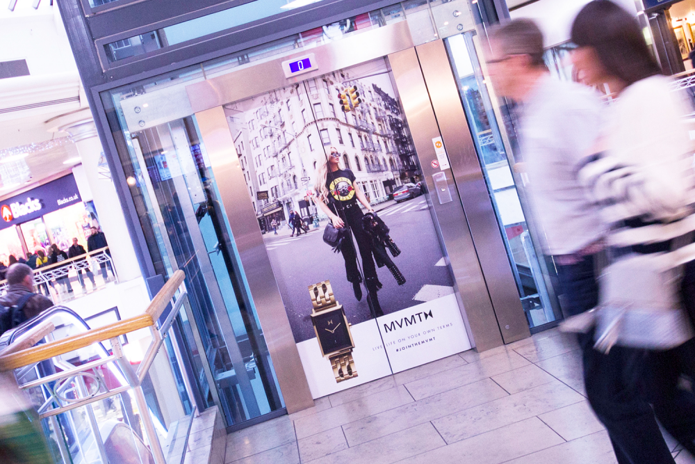 Advertisment displayed on the doors of an elevator in a shopping mall