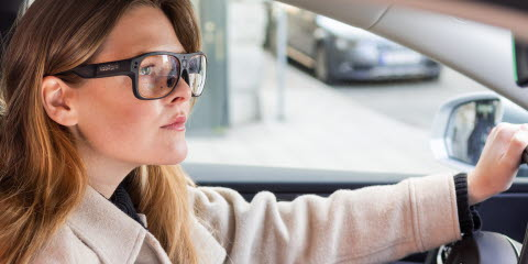 Woman driving a car using Tobii Pro Glasses 3 wearable eye trackers