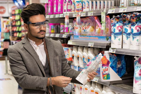 man shopping using eye tracking glasses