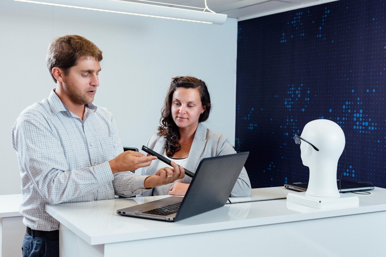 A man explains how to mount Tobii Pro X3-120 eye tracker on a laptop