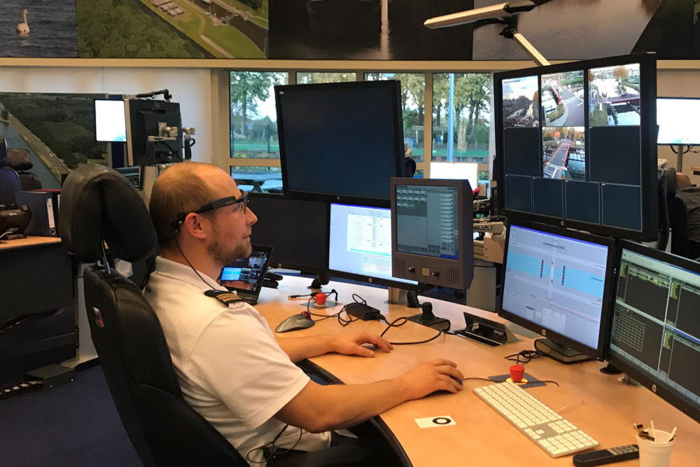 A bridge operator looking at screen using eye tracker glasses