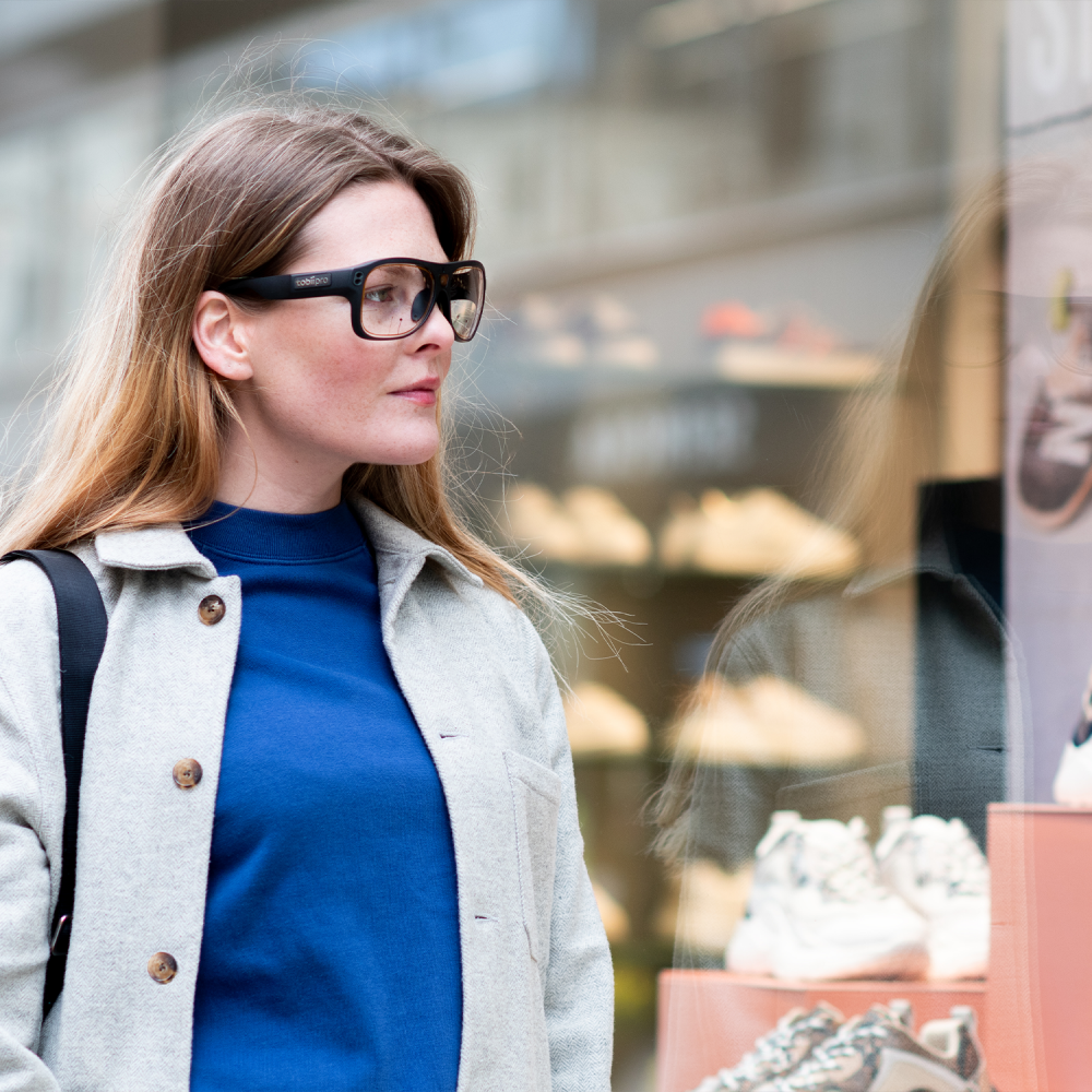 A woman looking at a window with Tobii Pro Glasses 3